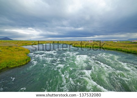 Summer Iceland landscape with big mountain river.
