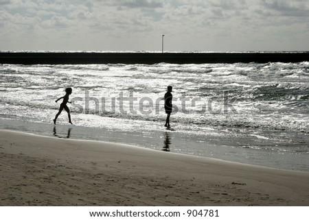summer in denmark:beach of loekken, people on the beach - stock photo