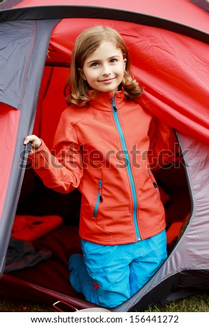 Summer in the tent - young girl on the camping
