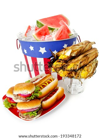 Summer July 4th Party Bucket With Watermelon Next To Burgers Hot Dogs and Corn