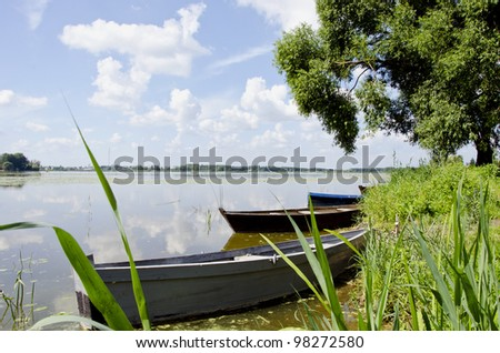 summer lake landscape with boats