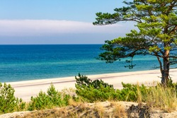 Summer landscape. A lonely beach with white sand and blue sea. View of Baltic sea coast.  Hel Peninsula, Hel, Pomerania, Poland