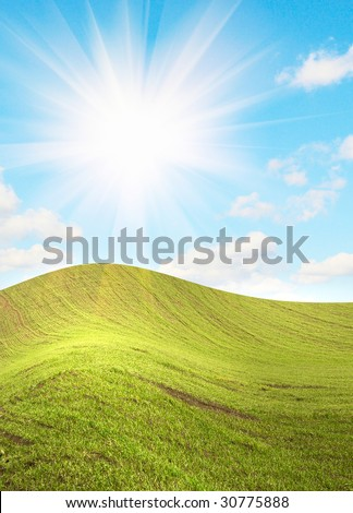 Summer landscape and beautiful sun beams over green field.