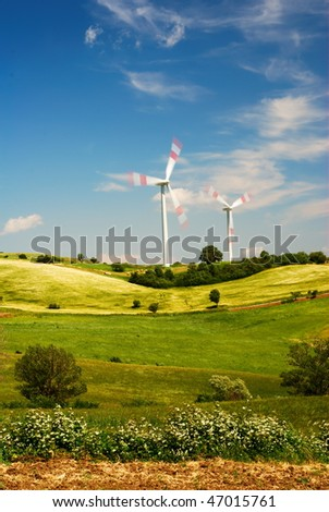 Summer landscape and wind turbines