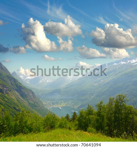 Summer landscape. Blue sky, mountains and fjord with ferry