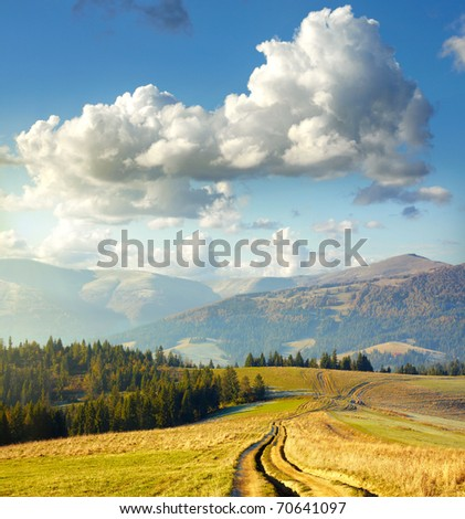 Summer landscape. Clouds and mountain road
