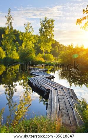 Summer Landscape. Colorful landscape with a wooden bridge over the river