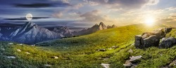 Summer landscape concept of Day and Night meet in High Tatra Mountains on a meadow with huge stones among the grass on top of the hillside near the peaks