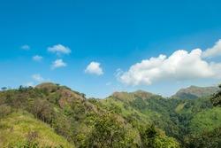 Summer landscape. Green hill and blue sky