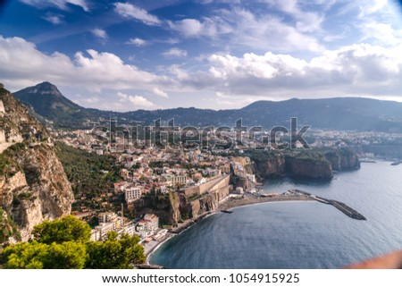 Summer landscape in mountains and blue sky clouds. High quality Footage, small town on the beach and rocks, olive trees, roads and buildigs, tourism travel village Piano de Sorrento, Italy