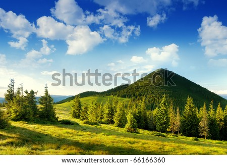 Summer landscape in mountains and the dark blue sky with clouds #66166360