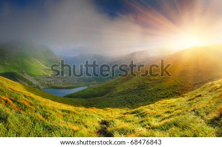 Summer landscape in the mountains near the lake. Sunrise