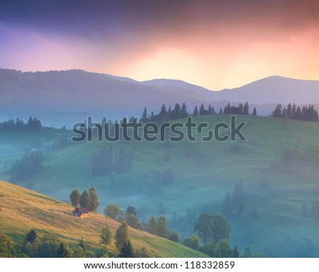 Summer landscape in the mountains village. Sunrise