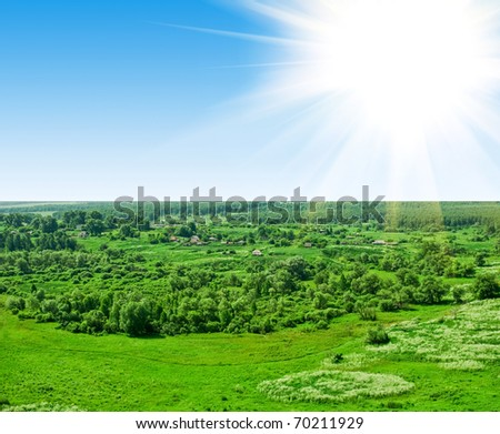 summer landscape of green valley and blue sky