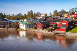 Summer landscape of Porvoo, Finland. Wooden houses stand along the river coast