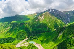 Summer landscape of the Caucasus Mountains, view of the gorge, Georgia in June