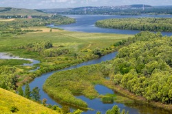 Summer landscape, river a large natural stream of water flowing in a channel to the sea, a lake, or another such stream. flood, nulla, effluent, ford. High hilly shores