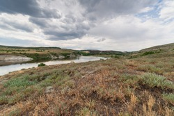 Summer landscape with a view of the river with steep banks. Volga River, Russia, Saratov region