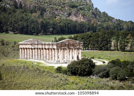 summer landscape with ancient Greek temple of Venus, Segesta village, Sicily, Italy