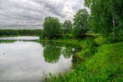 Summer landscape with forest and lake near Belovo village (Russia, Novosibirsk region)