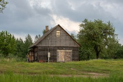 summer landscape with green grass and country house in Latgale region of Latvia
