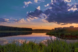 Summer landscape with riverbank at sunset. Wonderful nature, beautiful natural background.