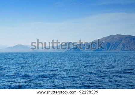 Summer landscape with sea and mountain range