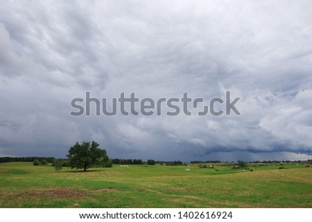 Summer landscape with stormy sky in Lithuania