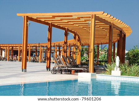 summer landscape with swimming pool and wood  pergola