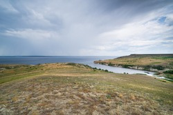 Summer landscape with views of the river with steep banks and the bay. Volga River, Russia, Saratov region