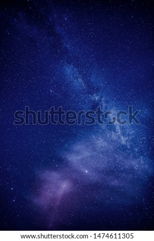 Summer Milky Way and Shooting star of the Perseid meteor shower in the night sky.