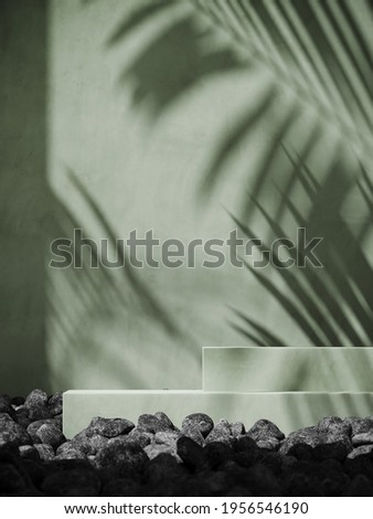 Summer mockup concept for product presentation. Green podium and pebble on green stucco background. Clipping path of each element included. 3d rendering illustration.