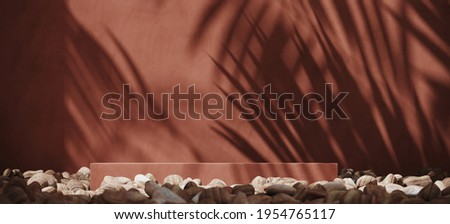 Summer mockup concept for product presentation. Red brown podium and pebble on brown stucco background. Clipping path of each element included. 3d rendering illustration.