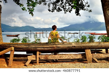 Summer morning, a woman in the lake scenery