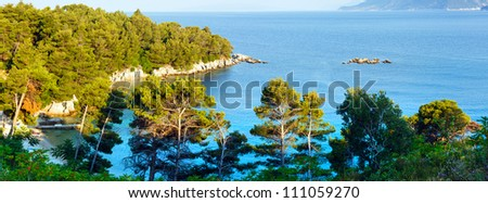 Summer  morning Adriatic Sea coastline view with beach and pine trees on shore  (Peljesac, Croatia)