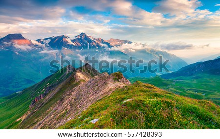 Summer morning view of Grossglockner mountain range from Grossglockner High Alpine Road. Colorful sunrise in Austrian Alps, Zell am See district, state of Salzburg in Austria, Europe.