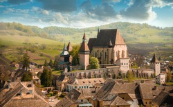 summer morning view of the cityscape of Biertan town Fortified Church, Transylvania, Romania, Europe