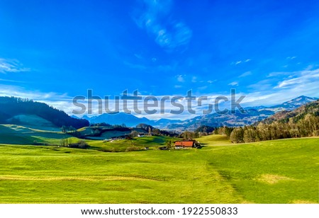 Summer mountain green field blue sky landscape. Mountain green valley meadow landscape. Green meadow in mountain valley. Summer green meadow in mountain valley