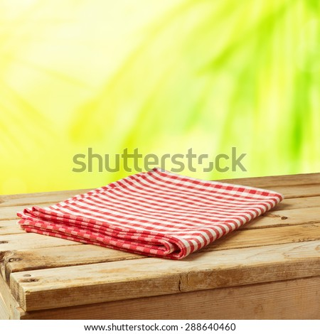 Summer nature background with wooden table and tablecloth