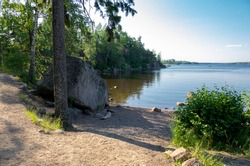 Summer nature of Mon Repos or Monrepos, extensive English landscape park in the northern part of the rocky island of Linnasaari (Tverdysh, Slottsholmen) outside Vyborg, Russia