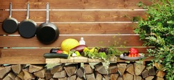 Summer Open Kitchen At The Backyard With Vegetables Harvest And Kitchen Utensils, Cookout Concept