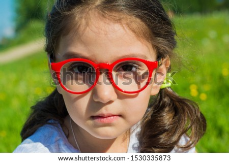Summer. Open space. Portrait of a girl. The girl is wearing glasses.