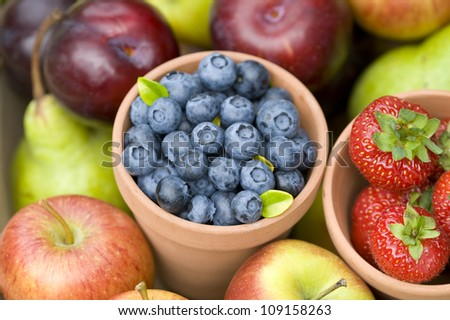 summer or autumn fresh fruit including: blueberries, strawberries, apples and pears