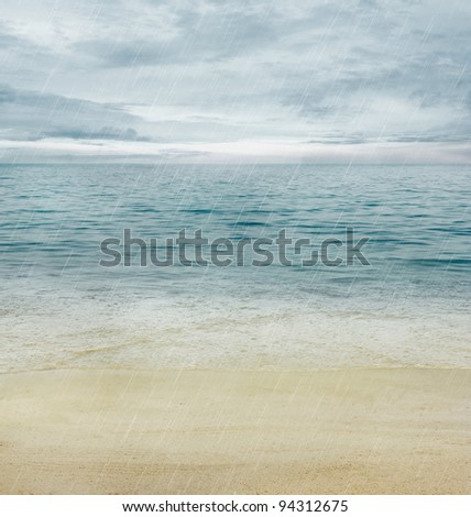 Summer  or spring abstract background. Rain summer nature with Golden sand with blue ocean and cloudscape and sunset in the back.