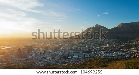 Summer panorama of dawn in the city on the background of the mountains (Cape Town, South Africa - Table Mountain)