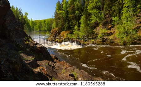 Summer panorama of the river with impassable, steep rapids and rocky shores #1160565268