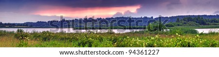 Summer panoramic landscape with river valley at sunset