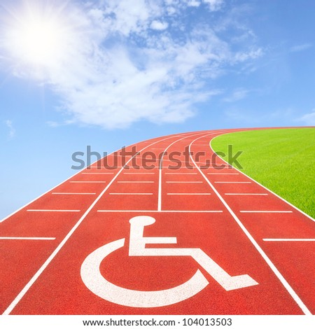 Summer paralympics concept with disability symbol on running track - stock photo