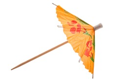 Summer party and drinking glass decoration concept with picture of colourful orange cocktail paper decorative umbrella isolated on white background with clipping path cutout