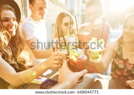 Summer party. Friends at cafe drinking and having fun #668044771